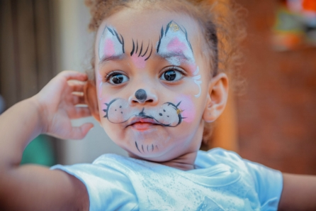 toddler with facepaint and speech delay