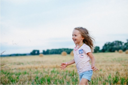 girl-running-in-field